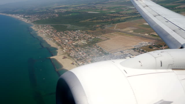 View of marine landscape from a window jet taking off from sicily video