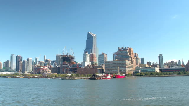 View of Midtown Manhattan skyline from sightseeing cruise boat on Hudson River video