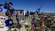view of Mount Erciyes through Turkish amulets in  Cappadocia video