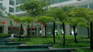 View of picturesque garden with fountain against modern building. Kuala Lumpur, Malaysia video