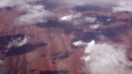 SLOW MOTION: View of red dry sandy landscape and big puffy white clouds video