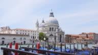 View of Santa Maria della Salute in Venice, Italy with gondolas rocking on water video