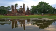 WS PL View of Sukhothai Historical Park, Mahathat temple reflecting in water video