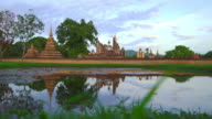 WS LD View of Sukhothai Historical Park, Mahathat temple reflecting in water video