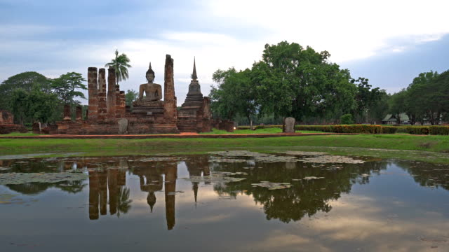 LD, WS View of Sukhothai Historical Park, Mahathat temple reflecting in water video