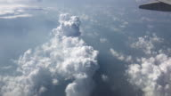 View of the clouds from airplanes window during the flight video