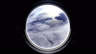 A view of the Earth from through the porthole of a spaceship. International space station is orbiting the Earth. Space, earth, orbit, ISS, NASA video