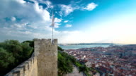 View of the historical Lisbon Baixa downtown and Tagus River, from the Sao Jorge St. George Castle in Lisbon, Portugal timelapse video