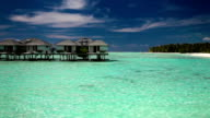 View of the over water villas and tropical island video