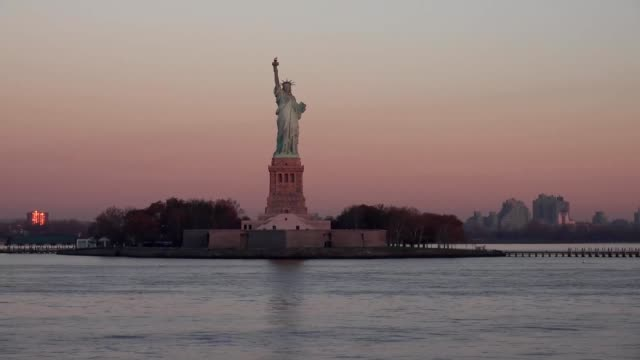 View of the Statue of Liberty and Ellis Island in sunset sunrise, New York State, Manhattan, North America, USA video