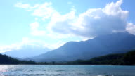View of tranquil bay and mountains, gentle surf video