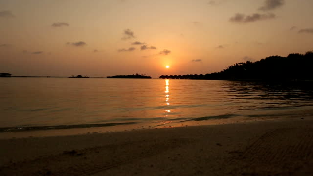 View of tropical lagoon with luxury Overwater Bungalows at sunrise or sunset on Maldives video