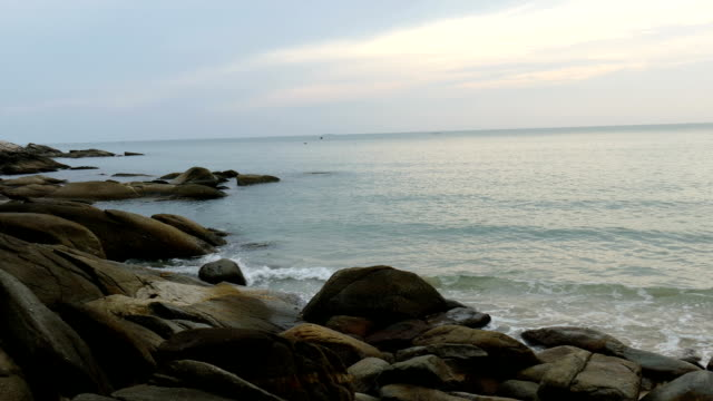 view of wave, sea, stone and beach in the morning video