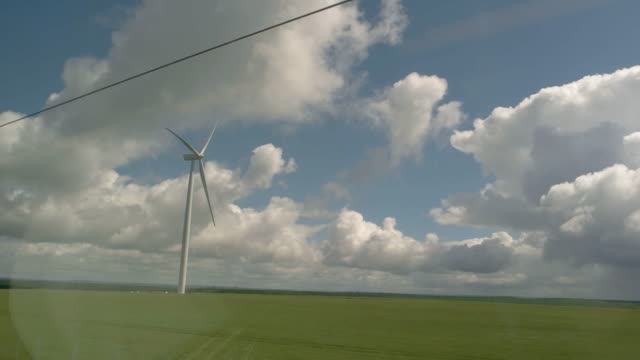 View of windmills from train. video