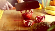 View of woman hands cutting pomegranate video