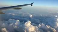 View out of plane window over clouds, some turbulence video