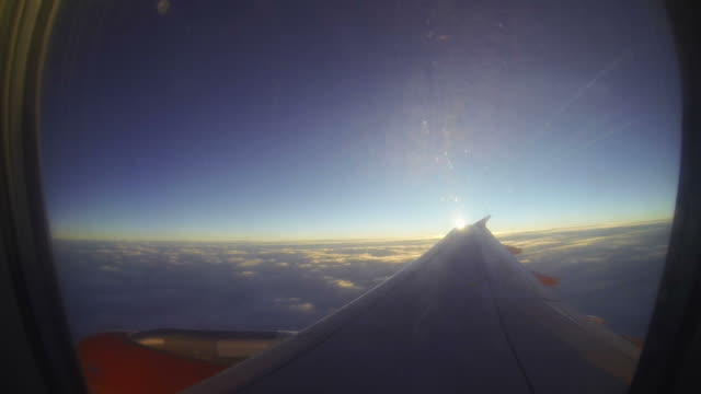 View out plane window to clouds video