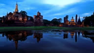 WS View PR of Sukhothai Historical Park, Mahathat temple reflecting in water video