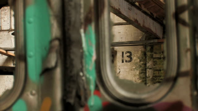 View through a derelict tram with graffiti video