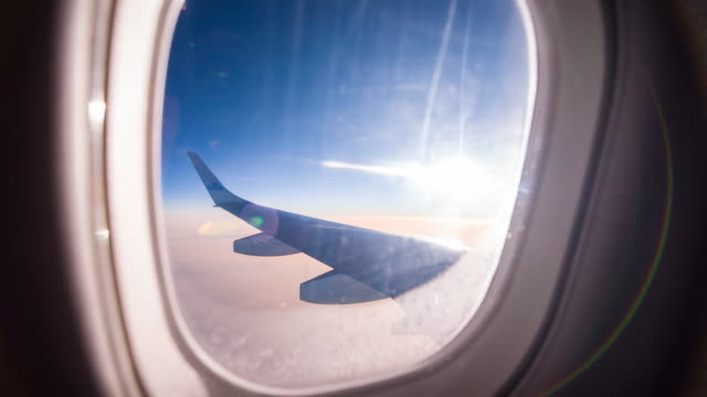 View through airplane window during flight video