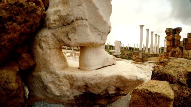 View through leg of antique white statue on Colonnade of Roman Agora ancient town Salamis video