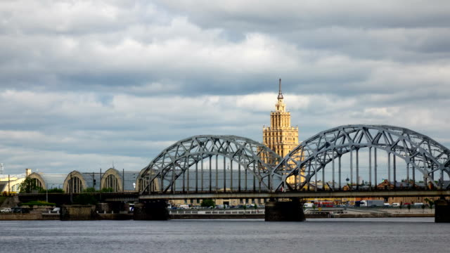 view through the Daugava River of the Riga railway bridge and the Building of Academy of Sciences of Latvia, Riga Latvia ,Time-lapse video