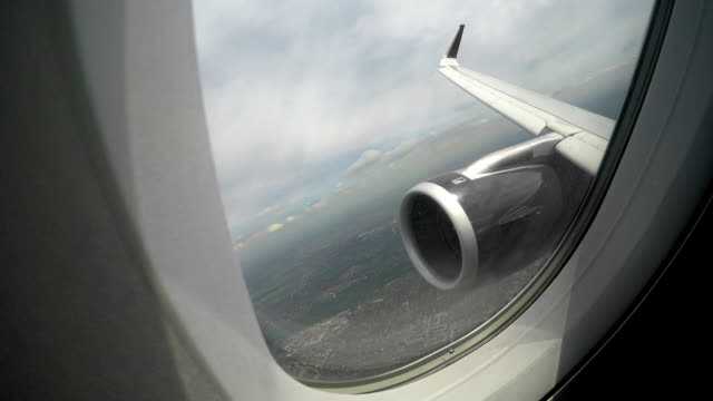 View through window at plane wing and engine, risk of accident during flight video