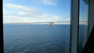 view to Oresund Bridge from a window of ferry. between demark and Sweden video