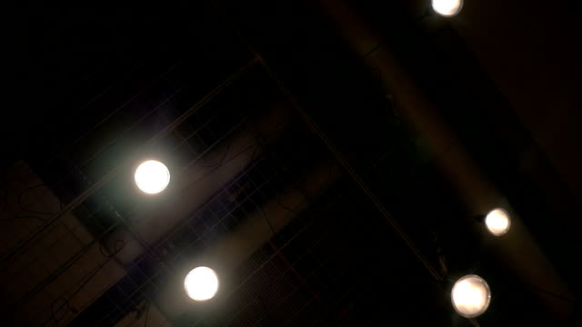 View to the dark ceiling with hanging lamps video