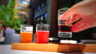 Vignette Shot, Beer Tasting Flight, Macro Shot of Hand at Pub, Summer Sun video