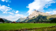 Village in Jungfrau valley with Swiss Alps Time Lapse - Stock Video - Stock Video video