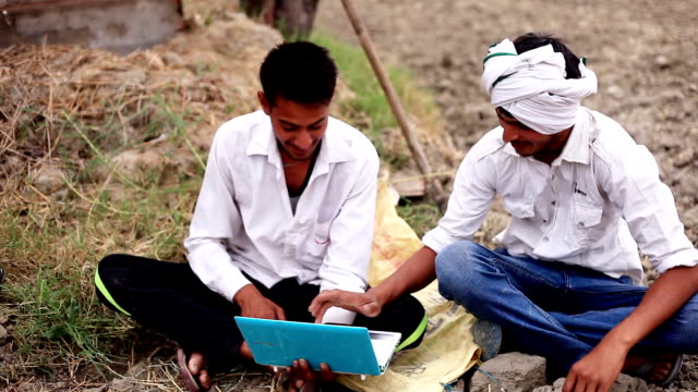 Village person using laptop video