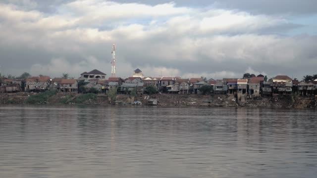 Village stilt houses on the riverside at low tide video