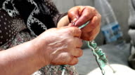 HD: Villager woman is knitting socks video