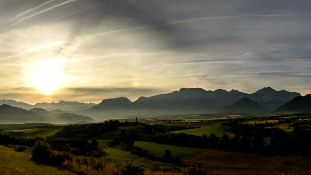 Villages in wide alpine valley Alpes de Haute Provence sun rising video
