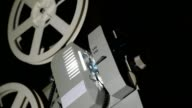 Vintage 8 Mm Movie Projector And Film Reel Closeup video