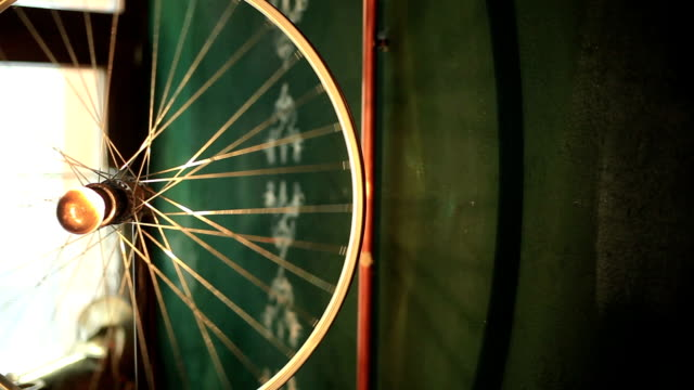 Vintage bicycle wheel rolling in the air close up video
