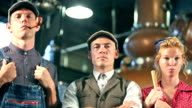 Vintage factory workers in old fashioned distillery video
