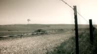 Vintage Film Grain Barbed Wire Windmill Farm video