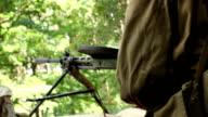 Vintage machine gun spits out series of bullet. World war video