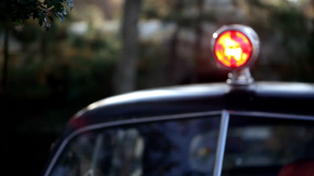 Vintage Police Car with Red Light Flashing (Video) video