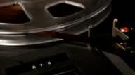vintage reel-to-reel recorder detail with rack in video