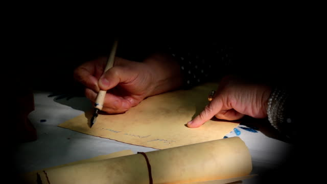 Vintage scene.Woman writing a letter with dip pen video