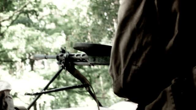 Vintage weapon, soldiers shoot from machine gun. Soviet uniform. video