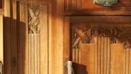 Vintage wood cabinet close up shot. Beautiful antique hand craft texture with sun light video