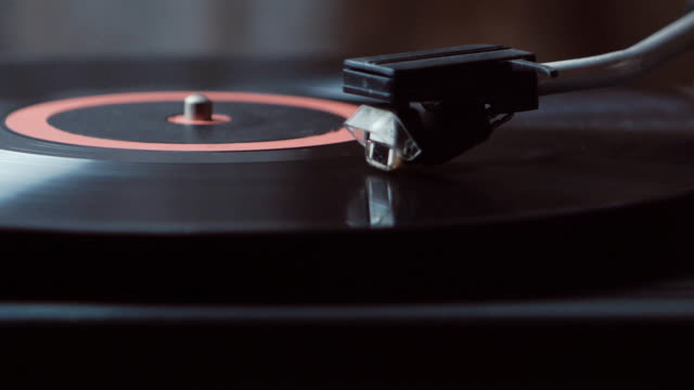 Vinyl rotating on a turntable. A record player turntable with it's stylus running along a vinyl record video
