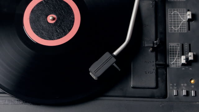 Vinyl rotating on a turntable, top view video