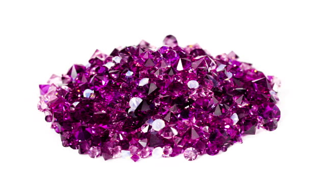 Violet jewel stones heap turning over white background video