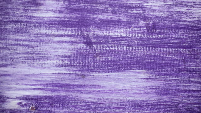 Violet painted wooden background in motion. 4K, UHD video