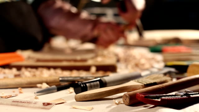 violin craftsman chipping violin part.Real time. video